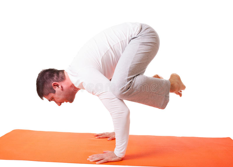 Handsome man practicing yoga isolated stock photos