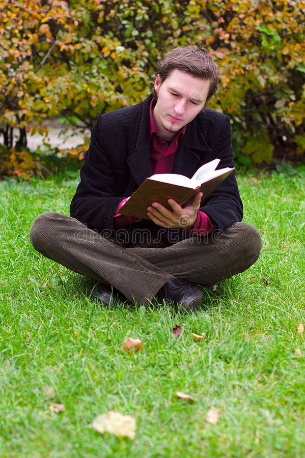 Download Handsome Man Reading Book On A Grass In Autumn Stock Image - Image: 21730761