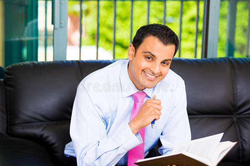 Handsome man reading royalty free stock photos