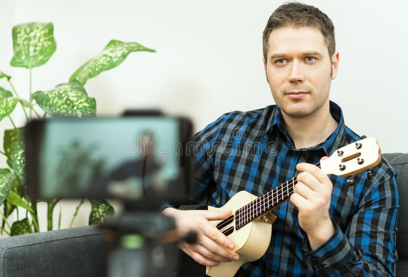Handsome man recording song. Vlogging concept royalty free stock photos