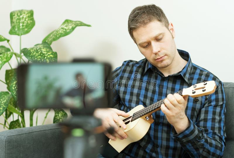 Handsome man recording song. Vlogging concept royalty free stock photography