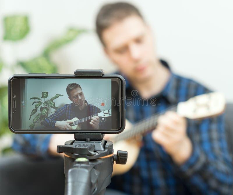 Handsome man recording song. Vlogging concept stock photos