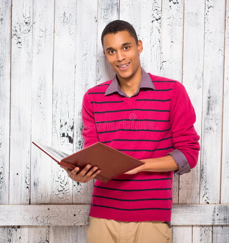 Handsome man with register or journal in studio stock images
