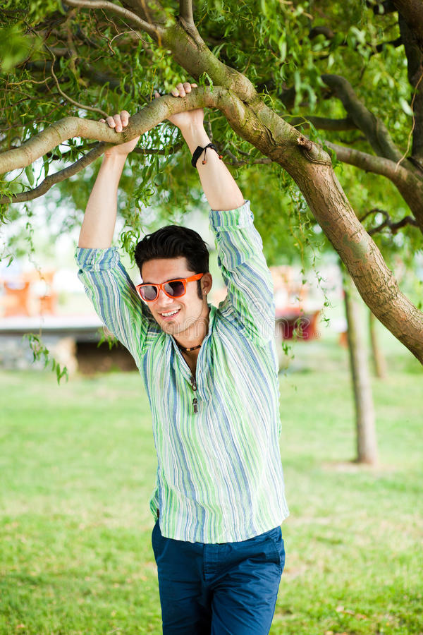 Download Handsome Man Relaxing In The Park Stock Image - Image of model, cheerful: 25486555
