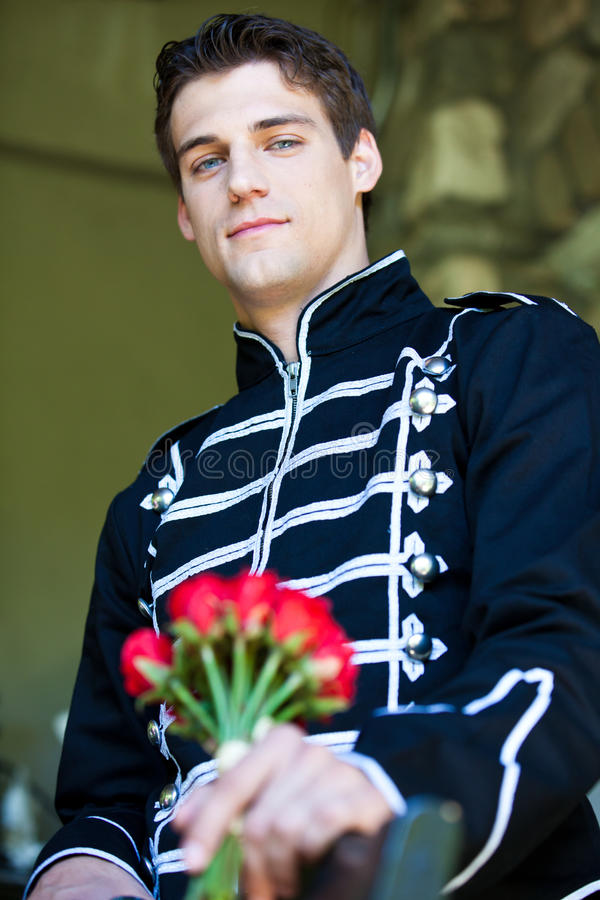 Handsome Man with roses stock photo