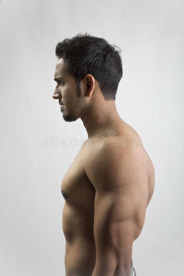 Handsome man showing his muscles. Showing his muscles after a workout royalty free stock photo