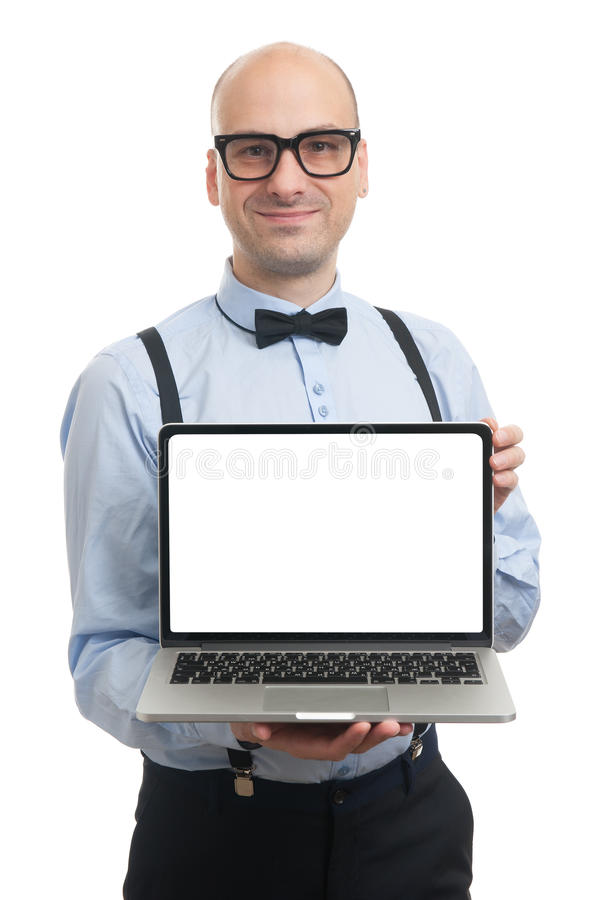 Handsome man showing something on laptop. Handsome guy with suspenders and bow-tie showing something on laptop royalty free stock photography