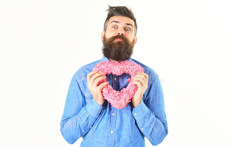 Handsome man with single heart royalty free stock photo