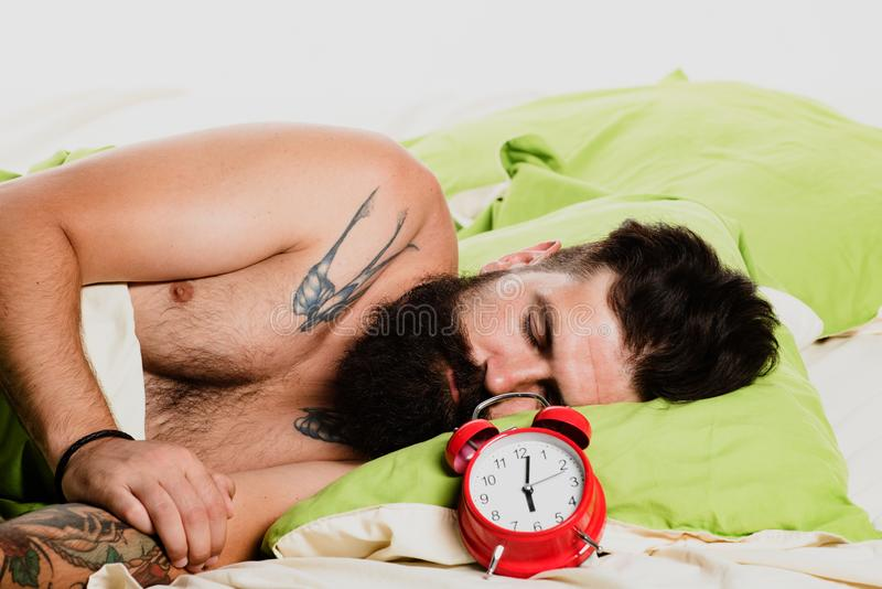 Handsome man sleeping in bed. Wake up Sleepy. Young man sleeping on soft pillows in bed at home. Handsome man sleeping in bed. Wake up Sleepy. Young man royalty free stock images