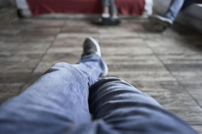 Handsome man sleeping in his sofa. Legs view.  royalty free stock images