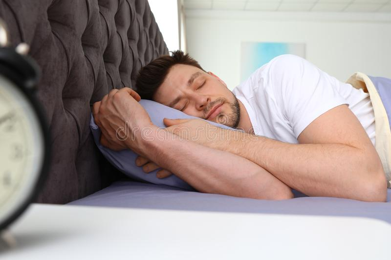 Handsome man sleeping on pillow at home royalty free stock photo