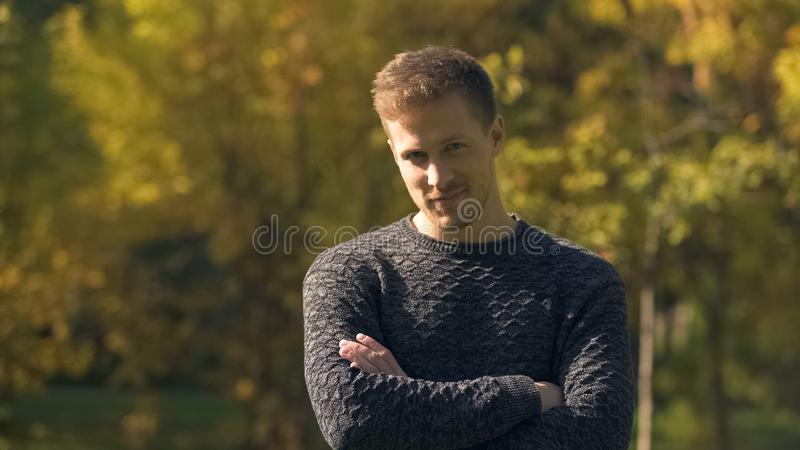 Handsome man smiling at camera, successful startupper, low credit interest rate stock images