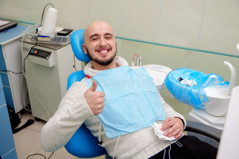 Handsome man with snow-white smile after a visit to the dentist royalty free stock photos