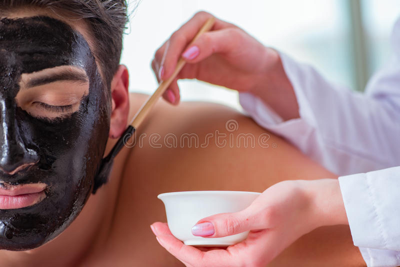 The handsome man in spa massage concept royalty free stock photo