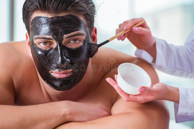 The handsome man in spa massage concept royalty free stock images