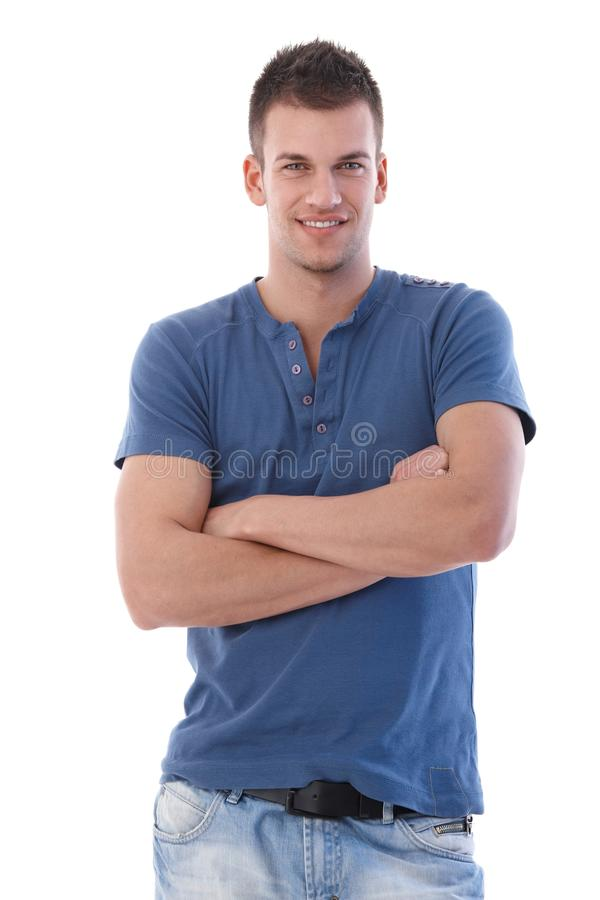 Handsome man standing arms crossed smiling