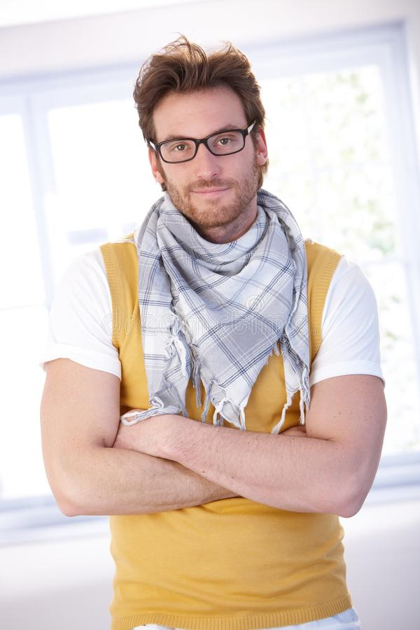 Handsome man standing arms crossed smiling stock images