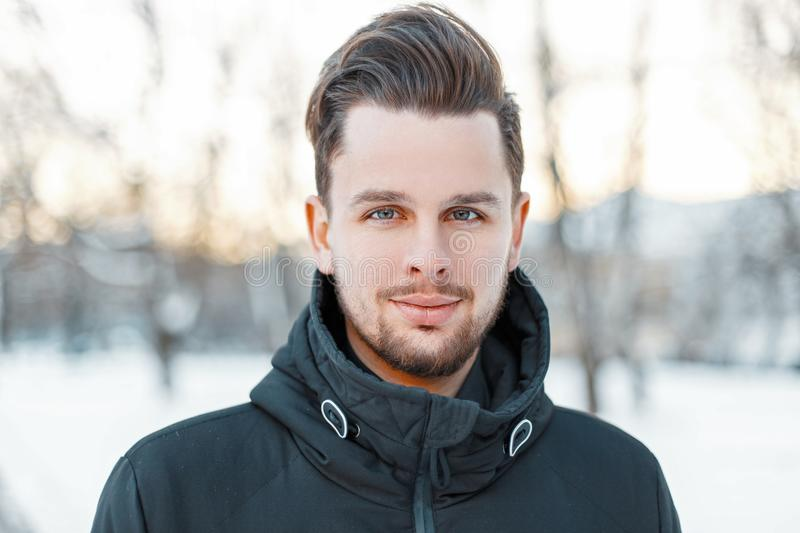 Men`s handsome face with hair and beard in winter sunny day royalty free stock images