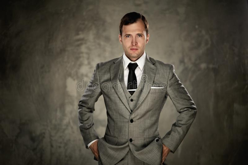 Handsome man in a suit stock images
