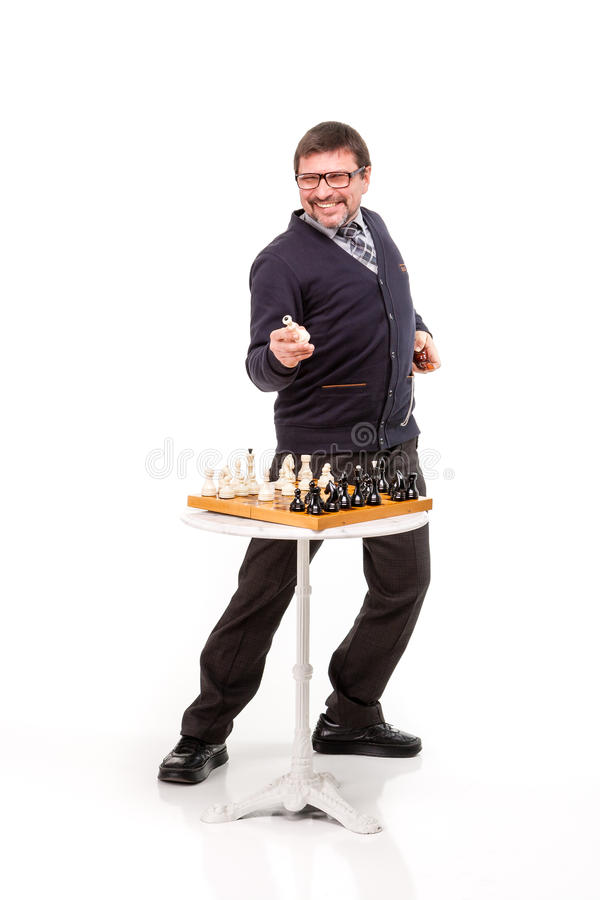 A handsome man in a suit and glasses, with a pipe for smoking an stock photo