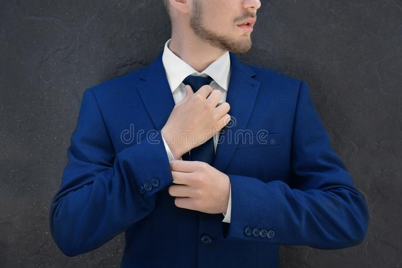 Handsome man in suit. Outdoors stock photo
