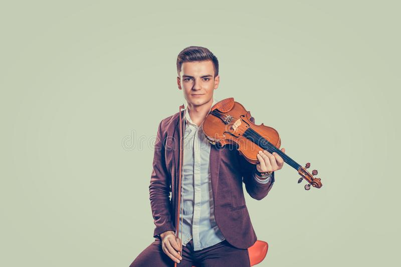 Handsome man in suit with violin royalty free stock photos