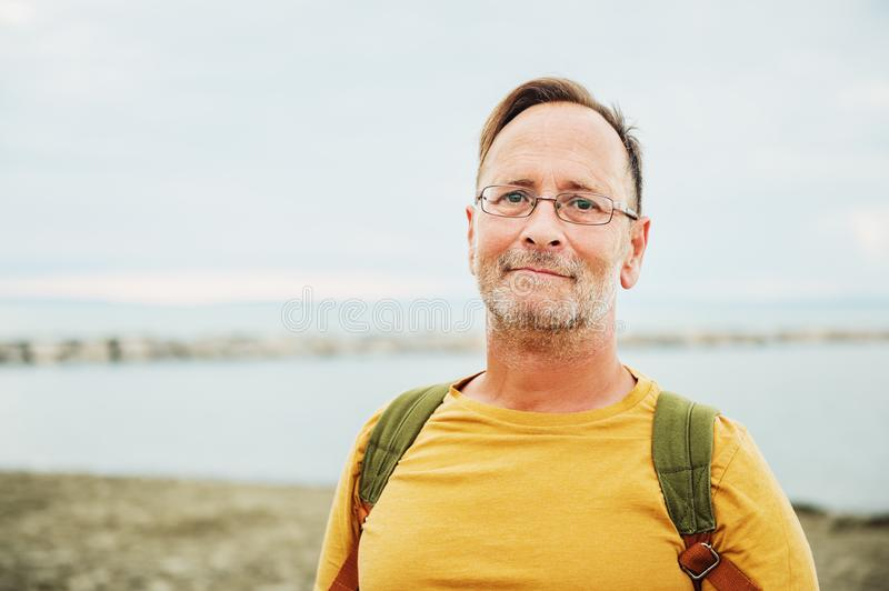 Handsome man on summer vacation stock images