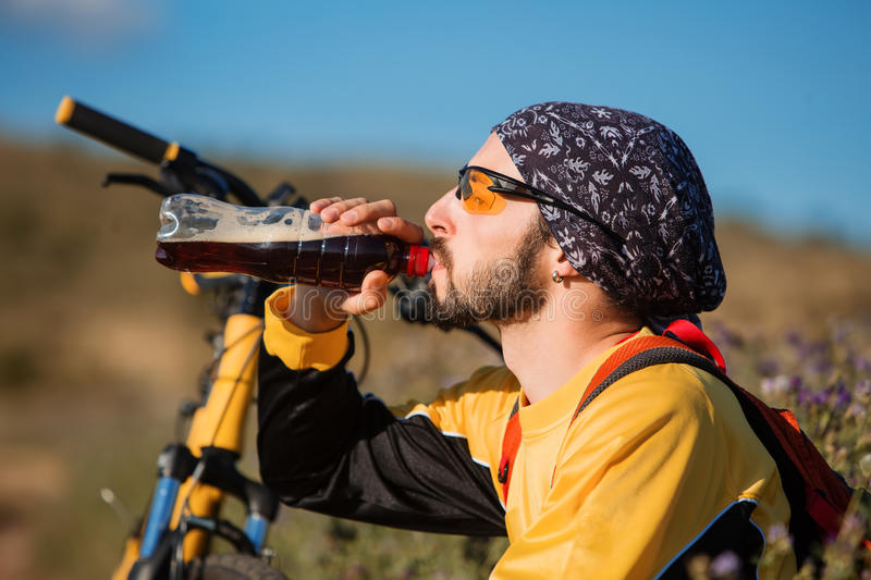 Handsome man taking a break after cycling training royalty free stock photos
