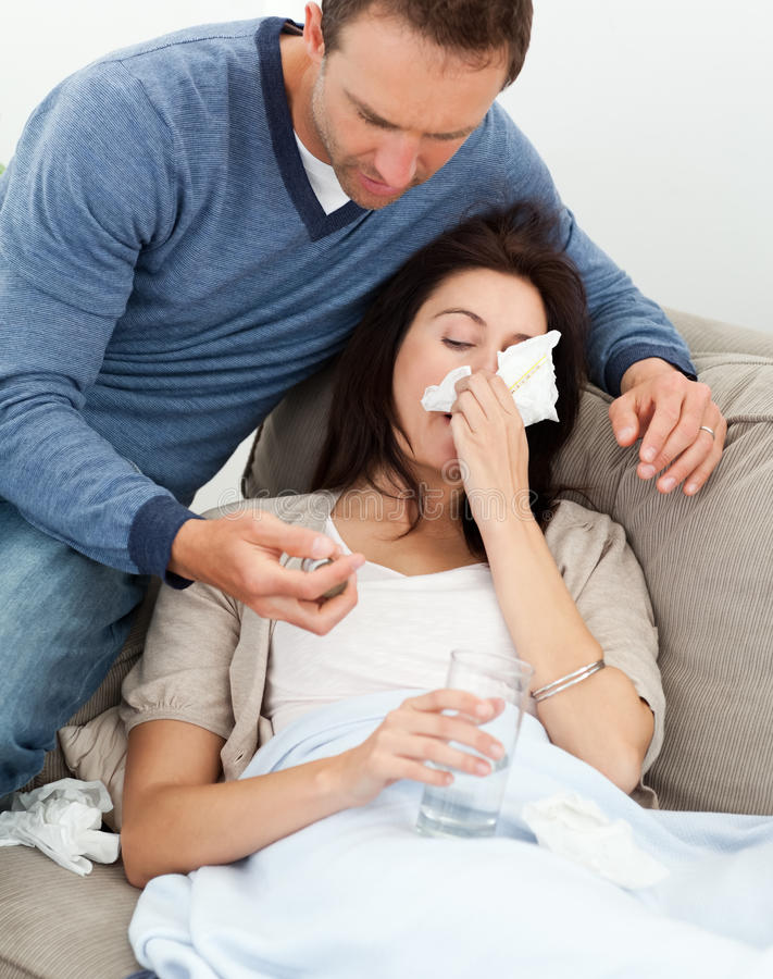 Download Handsome Man Taking Care Of His Sick Girlfriend Stock Image - Image: 17468893