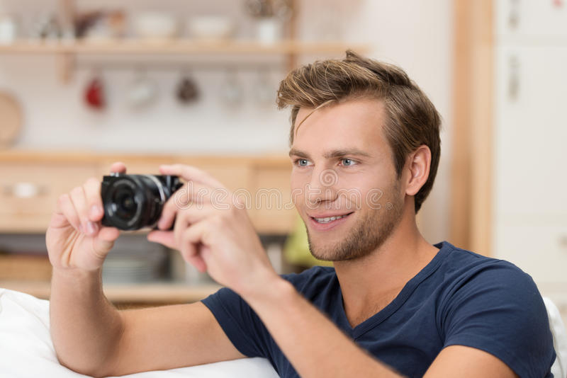 Handsome man taking a photograph stock images