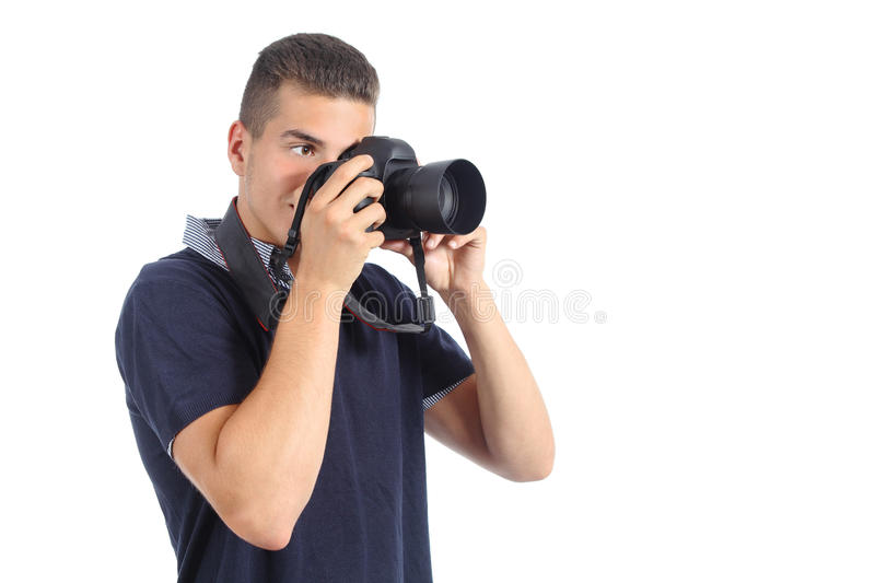 Handsome man taking a photography with a slr camera. Isolated on a white background royalty free stock photography