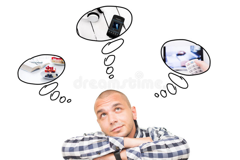 Handsome man thinking how to spend free time royalty free stock photography