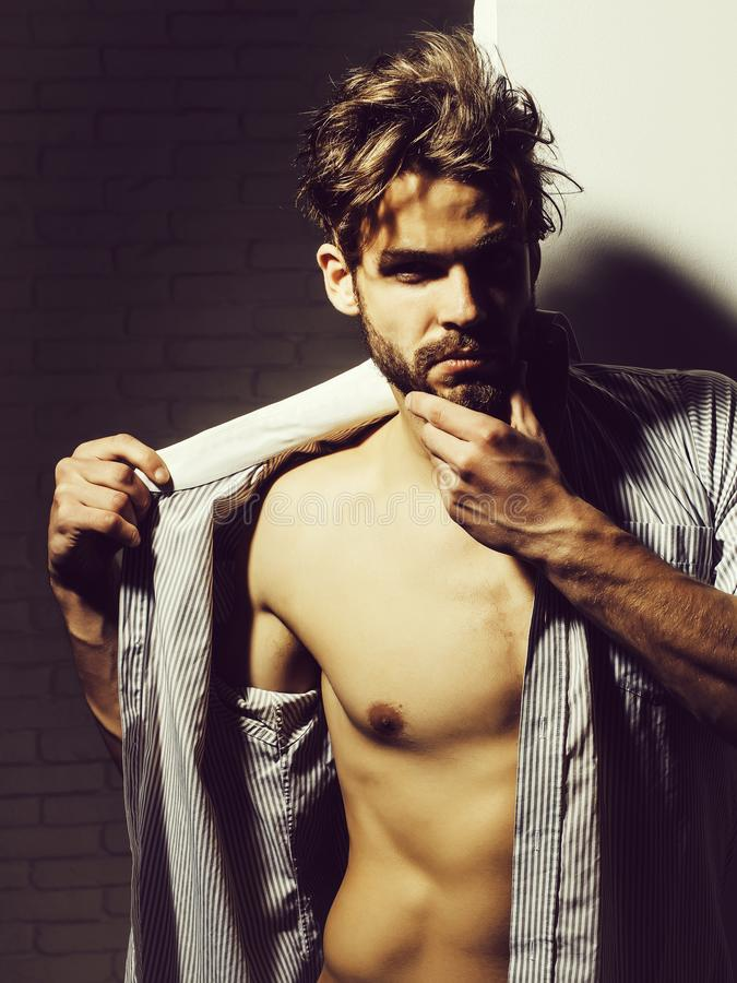 Free Handsome Man Touches Beard Royalty Free Stock Image - 129469546