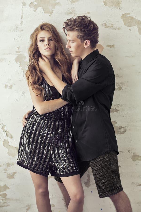 Handsome man touching young beautiful woman stock photos