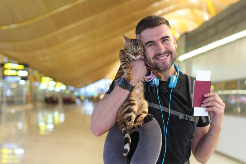 Handsome man traveling with his cat stock photo