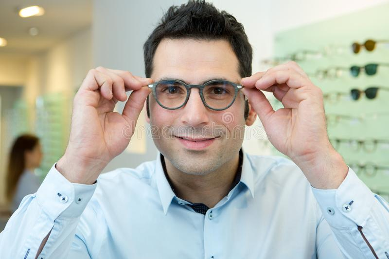 Handsome man trying eyeglasses royalty free stock images