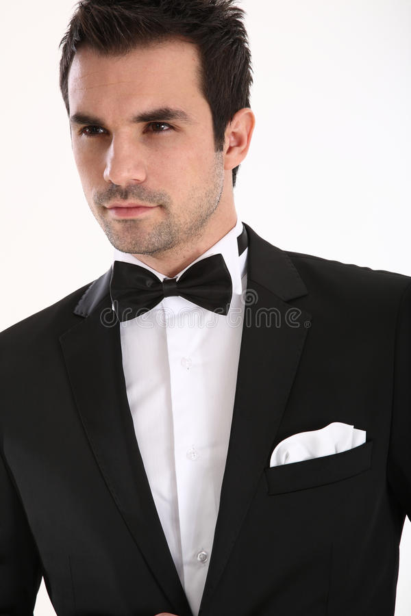 Handsome man in tuxedo. Handsome caucasian man in tuxedo stock photo