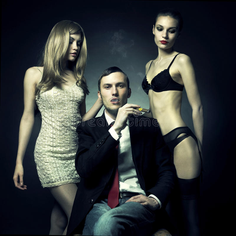 Handsome Man And Two Women Stock Images