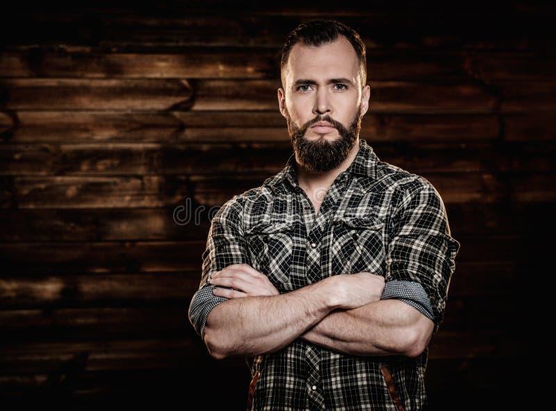 Handsome man wearing checkered shirt royalty free stock image