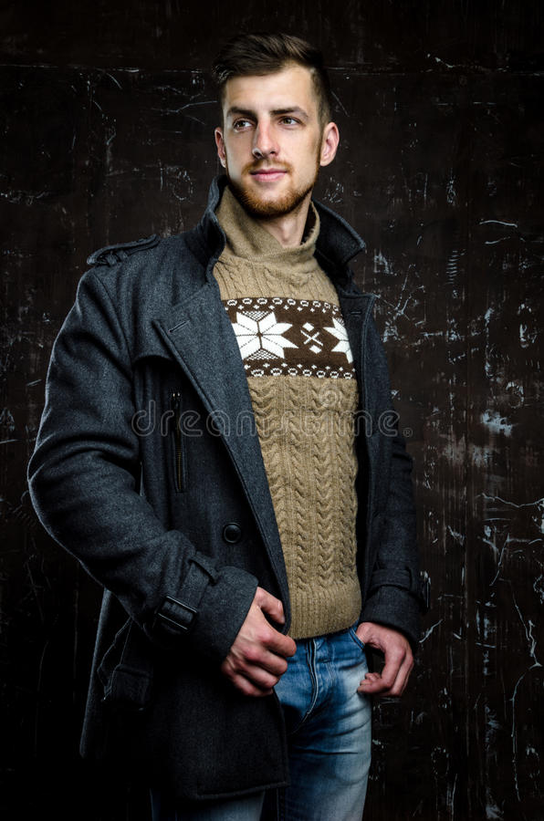 Handsome man wearing coat royalty free stock photos