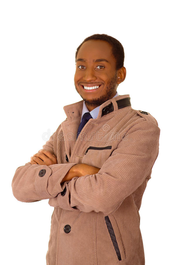 Handsome man wearing stylish light beige corduroy jacket standing in front of camera smiling with arms crossed, white stock images