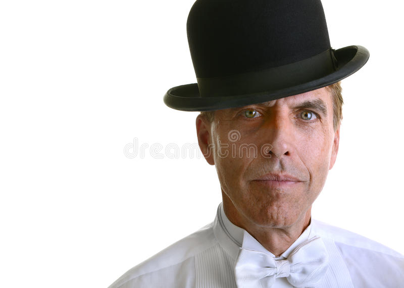 Handsome man wearing a white shirt and bowler hat stock image