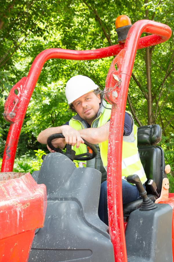 man worker at construction machinery of construction site mining company royalty free stock photo
