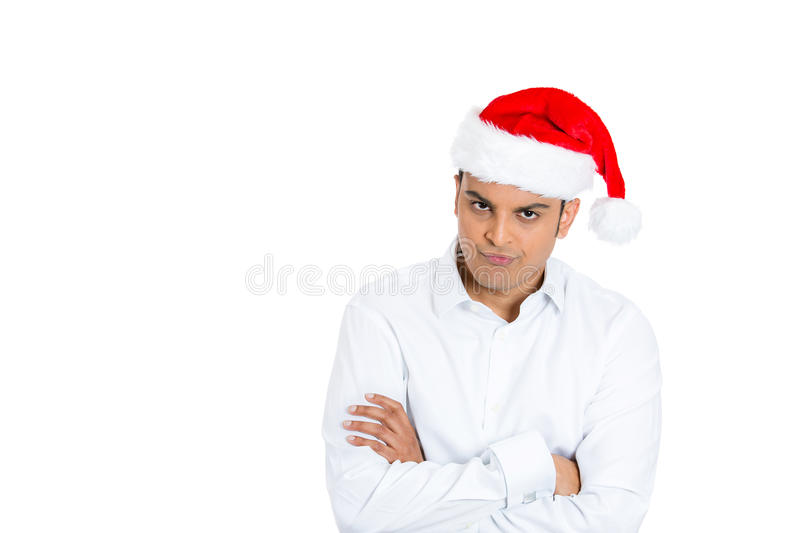 A handsome man in xmas hat showing arrogance and attitude stock photos
