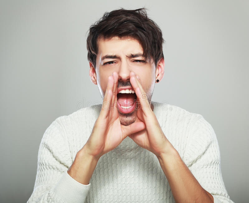 Handsome man yelling stock photography