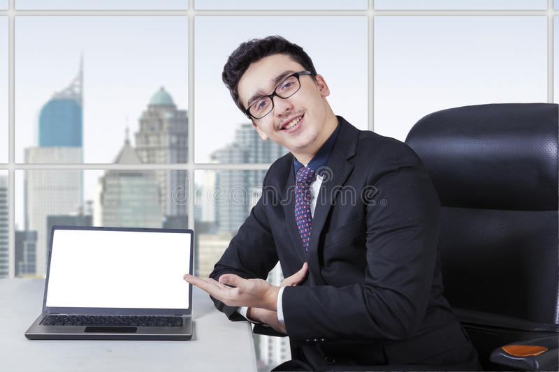 Handsome manager with blank laptop screen stock images