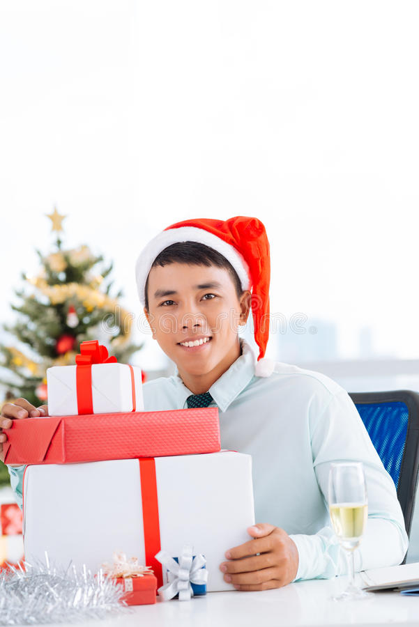 Handsome manager with Christmas gifts stock photography