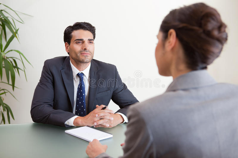 Download Handsome Manager Interviewing A Female Applicant Stock Photo - Image: 22236508