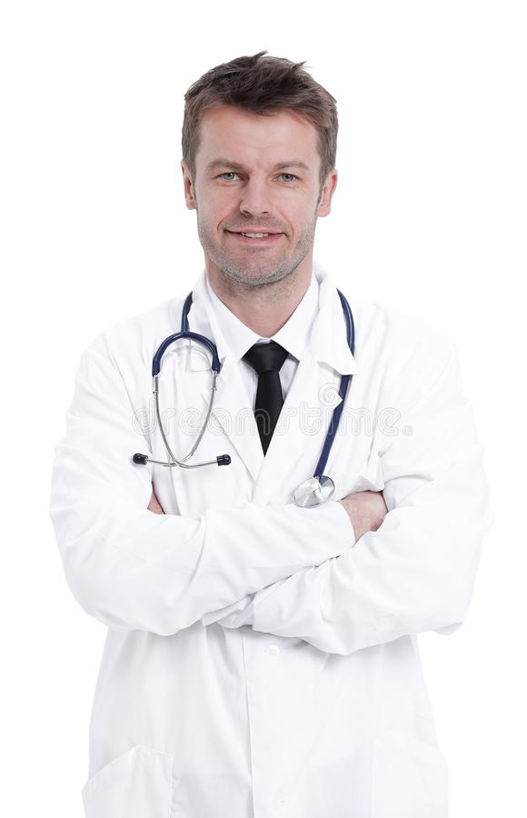 Handsome mature doctor is looking at camera while standing with folded arms. Isolated on white background stock image