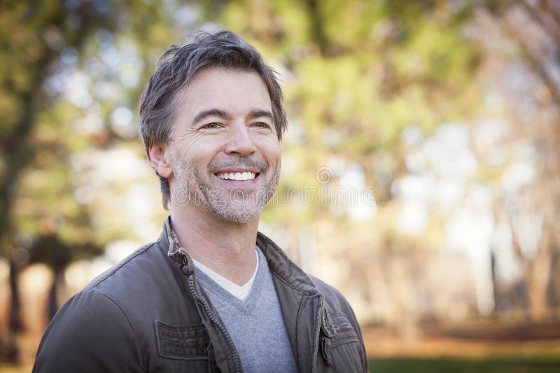 Handsome Mature Happy Man Smiling At The Camera stock image